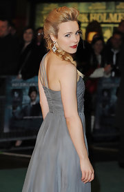 "The ""Sherlock Holmes"" star looked stunning in a textured volume french braid. This style showed off her diamond dangling earrings and looked beyond elegant. Love this on her!"