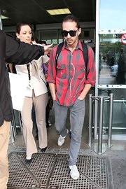 Shia LaBeouf topped off his travel get-up with a pair of wayfarers.