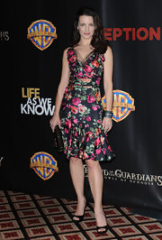 "Kristin looked lovely in a floral-printed Fall 2010 cocktail dress with a black lace-trimmed neckline. This look was so ""Charlotte"". Love it!"