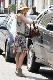 Sienna Miller carried a brown leather handbag with her around Primrose Hill.