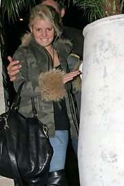Jessica kept warm on a chilly night in this camo hooded jacket with luxe fox fur trim.