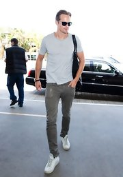 Alexander Skarsgard chose a comfy gray tee for his look while flying out of LA.
