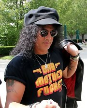 Slash visited a Boston radio station garbed in his customary black, topped off with a newsboy cap.