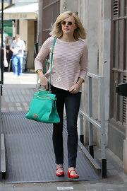 Fearne Cotton added a bold color to her look with a teal green shoulder bag.