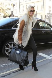 Kate Moss headed out in London wearing a pair of black suede ankle boots featuring wooly fringes.