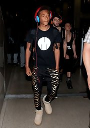 Jaden Smith rocked a pair of black and gold zebra-print harem pants during a flight to LA.