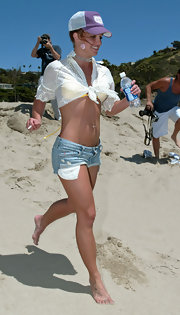 Britney Spears tosses on a purple mesh baseball cap while hitting the beach in Malibu.