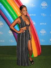 Christina Milian paired her sexy top with a matching mullet maxi skirt.