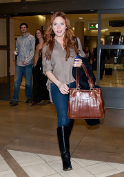 Brittany Snow matched her new auburn tresses to her cognac leather tote.
