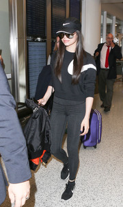 Sofia Carson caught a flight looking sporty in a black-and-white Nike sweatshirt.