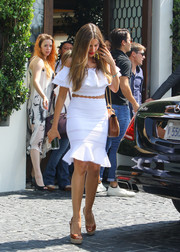 Sofia Vergara oozed ultra-girly appeal in a white off-the-shoulder crop-top by Alexander McQueen while grabbing lunch at Cecconi's.