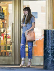Sofia Vergara accessorized with a tan bucket bag by Mansur Gavriel while running errands.