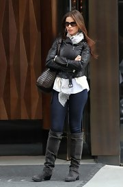 Sofia Vergara went for a tougher street style with gray slouchy suede knee high boots.