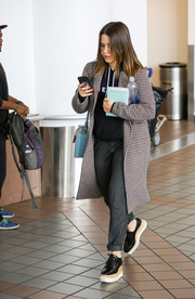 Sophia Bush was spotted at LAX looking casual in baggy gray slacks.