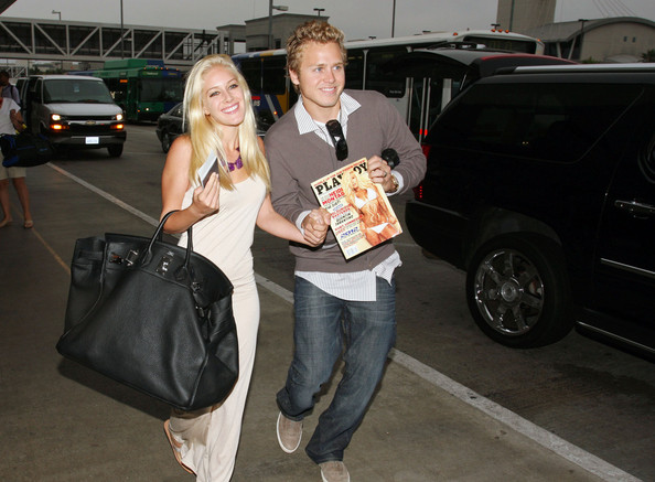 """Heidi traveled with a black leather """"Birkin"""" bag that looked big enough for her to fit in! What could she possibly be carrying?"""
