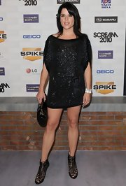 Neve showed off a sparkling tunic dress, which she completed with Quito snakeskin heels.