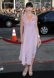 Delphine Chaneac showed off her figure in a flowing soft pink dress.