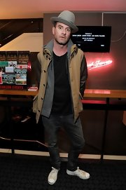 James Lavelle sported this tan fitted utility jacket with leather sleeves over a gray hoodie for a mix of casual and edgy.