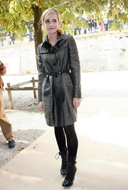 Emma showed off her sleek style in a gray trench coat.