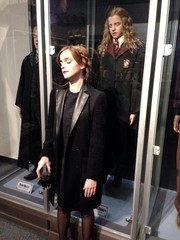 Emma Watson was edgy-stylish in a leather-lapel coat while posing next to a Hermione wax figure.
