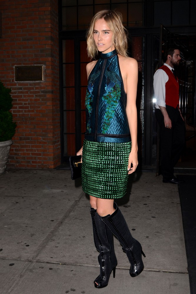 Attendees of the 2012 Met Ball exit the Bowery Hotel en route to attend the event.
