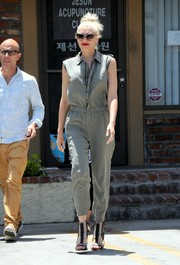 Gwen Stefani was her usual stylish self in a sleeveless gray jumpsuit while visiting an acupuncture clinic.