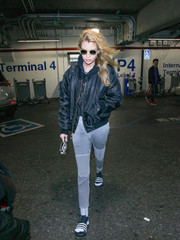 Stella Maxwell teamed ribbed gray sweatpants with a padded bomber jacket for a flight.