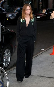 Stella McCartney showed a bit of cleavage in a black shirt unbuttoned halfway down.