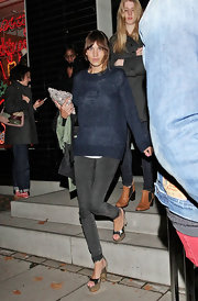 Alexa Chung wore this cozy sheer blue sweater with skinny jeans to the Stella McCartney store event.