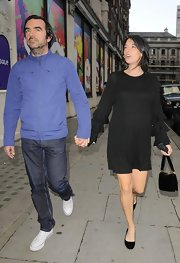 Mary McCartney made her way to a dinner party in London looking effortlessly stylish in a chic ruffled-sleeve black dress.