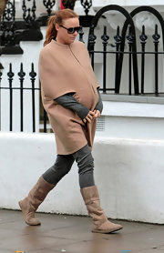 Due any day now, the very pregnant Stella McCartney stays warm in a zip up cape.