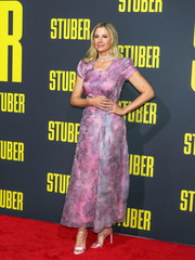 Mira Sorvino looked lovely in a pink floral dress by Armani at the premiere of 'Stuber.'