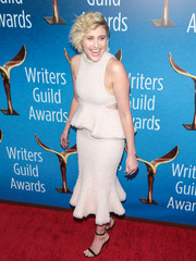 Greta Gerwig paired her dress with simple black sandals by Christian Louboutin.