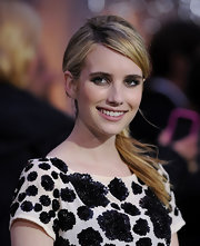 Emma Roberts paired her embellished frock with a sleek side ponytail.