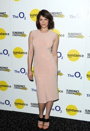 Gemma Arterton matched her dress with chic black and gold sandals.