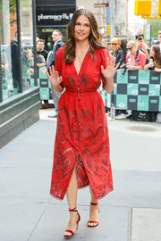 Sutton Foster looked fetching in an embroidered red dress by Sea NY while attending a Build series event.