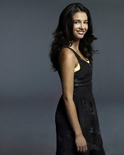 Naomi Scott posed for the  'Terra Nova' promo portrait wearing a casual day dress.
