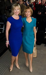Nude patent pumps paired perfectly with Sian Williams classic blue day dress.