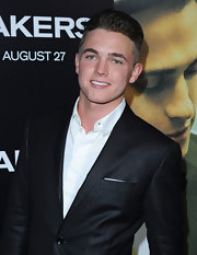 Jesse McCartney sports a modernized hightop fade hairstyle. His hair is shaved around his head but at least 3 or 4 inches long on top.