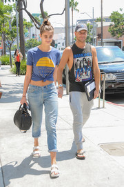 Taylor Hill covered up her supermodel legs with a pair of baggy boyfriend jeans.