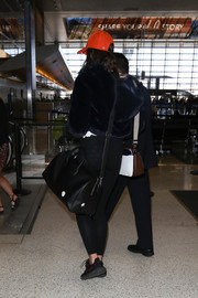 Taylor Hill was seen at LAX carrying a black leather duffle.