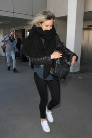 Taylor Schilling stayed comfy all the way down to her white leather sneakers.