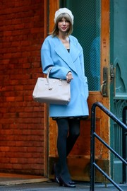 Taylor Swift was a bright and refreshing sight in cold New York in this turquoise ASOS coat.