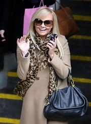 Emma Bunton looked ultra-chic ina patterned leopard print scarf while out in London.