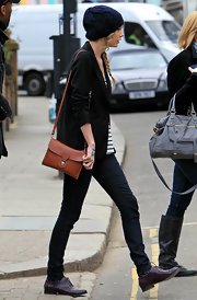 Taylor Swift went shopping in Notting Hill with her trusty cognac leather covered lock Cartridge bag in tow.