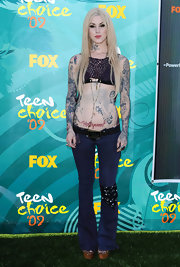 While attending the Teen Choice Awards Kat showed off her angel tattoo on her belly.