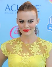 Holland's pretty red lips matched the fiery hue of her red locks.