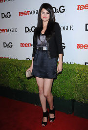 Selena Gomez wears black cutout ankle boots with her sophisticated ensemble at the Teen Vogue party.