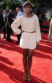 Estelle stepped onto the red carpet of the ESPY Awards wearing a beaded ivory frock. The singer belted the style and wore her hair in her signature pixie 'do.