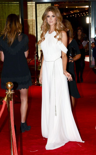 Delta Goodrem chose a white Grecian dress with a halter neckline and draped sleeves for her 2012 Logie Awards red carpet look.